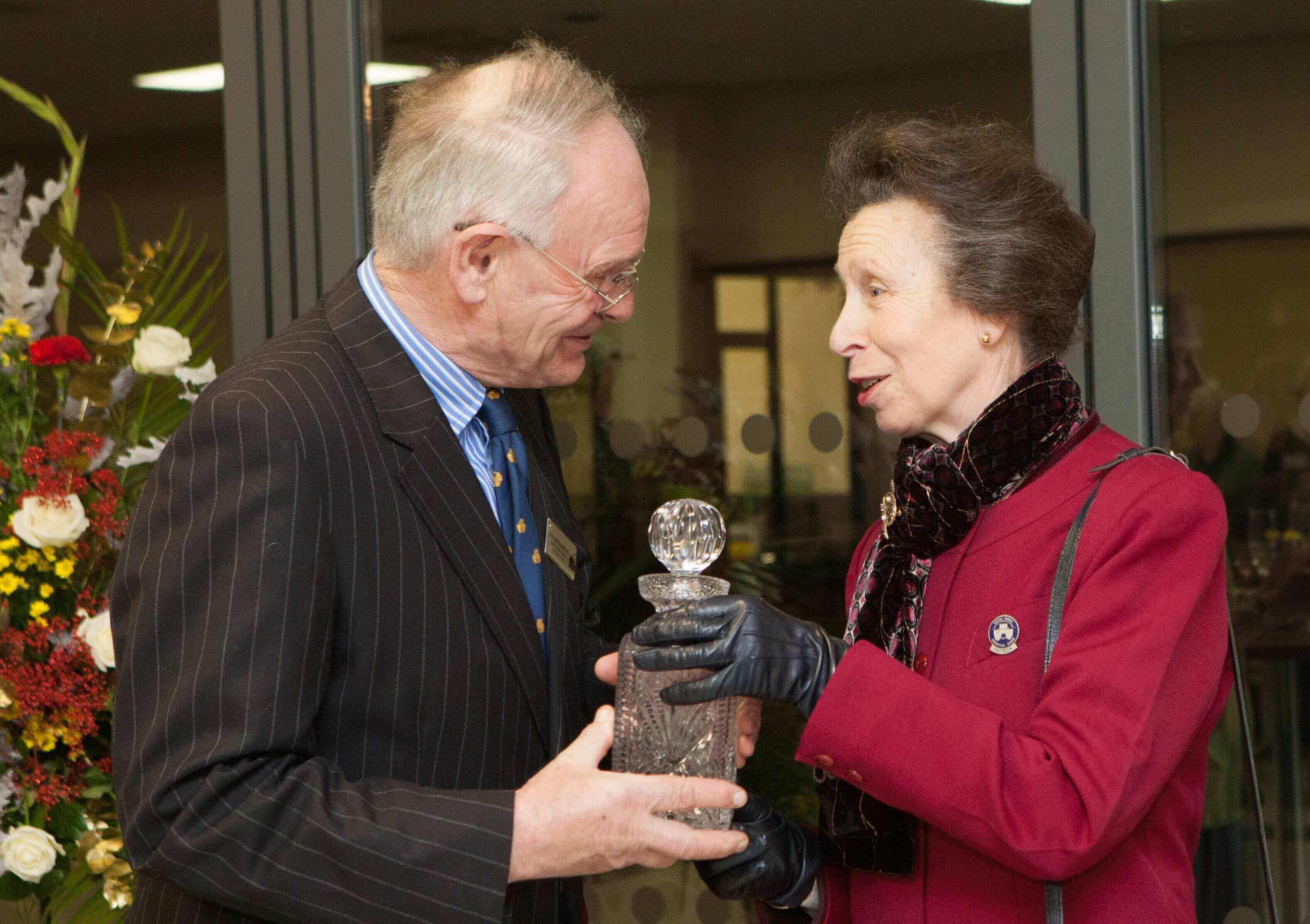 Michael Blandford receiving a crystal decanter from HRH The Princess Royal as a thank you as he retired as Chairman of Council at Three Counties.jpg